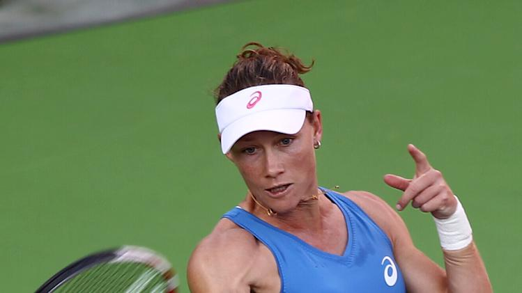 Samantha Stosur of Australia returns the ball to Maria Sharapova of Russia in the quarterfinal of the WTA Qatar Ladies Open tennis tournament in Doha, Qatar, Friday, Feb. 15, 2013. (AP Photo/Osama Faisal)