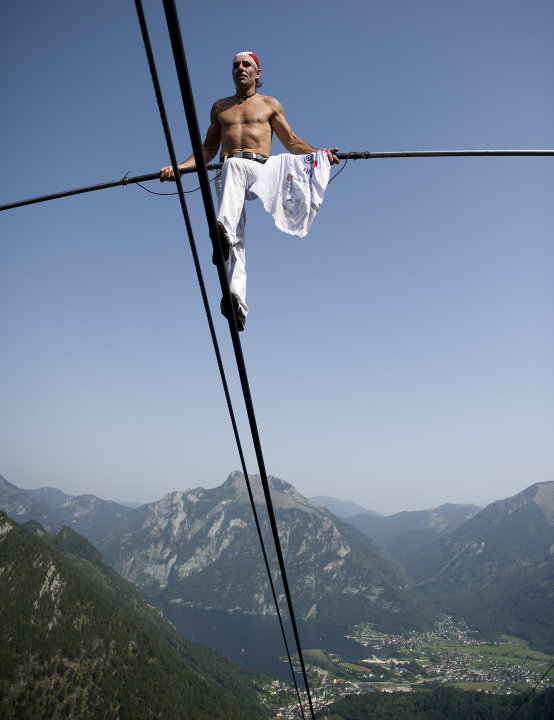 High wire artist Freddy Nock balances as he walks up on the rope of a Feuerkogel cable car in Ebensee, Austria, Monday, Aug. 22, 2011.  He is attempting to set a new world record by doing seven summit