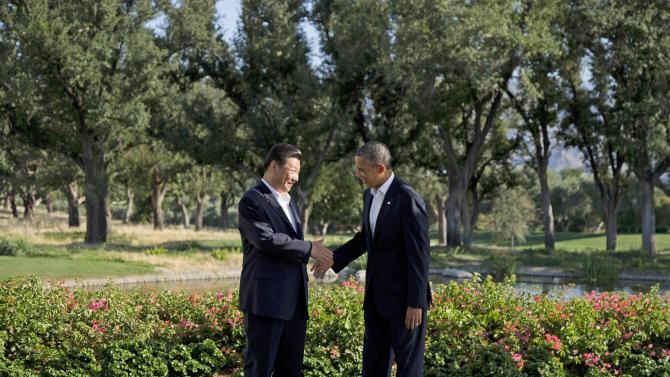 President Barack Obama shakes hands with Chinese President Xi Jinping at the Annenberg Retreat at Sunnylands as they meet for talks Friday, June 7, 2013, in Rancho Mirage, Calif. Seeking a fresh start to a complex relationship, the two leaders are retreating to the sprawling desert estate for two days of talks on high-stakes issues, including cybersecurity and North Korea's nuclear threats. (AP Photo/Evan Vucci)