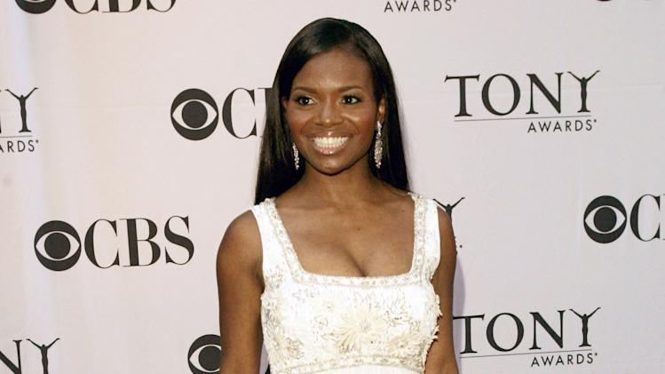 "FILE - This June 11, 2006 file photo shows actress LaChanze, from the ""The Color Purple,"" at the 60th annual Tony Awards in New York. Producers of ""If/Then"" said Monday, July 29, 2013, that LaChanze will star opposite Idina Menzel in the new musical set for March 2014. (AP Photo/Seth Wenig, File)"