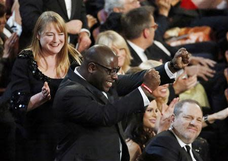 """British director and producer of """"12 Years A Slave"""" celebrates after being awarded best picture at the 86th Academy Awards in Hollywood"""