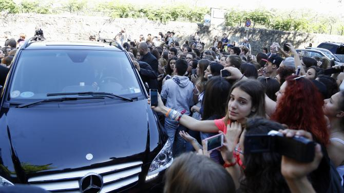 Fans crowd outside Forte Belvedere in Florence, Italy, Saturday, May 24, 2014. Kim Kardashian and Kanye West will wed and host a reception at Florence's imposing 16th-century Belvedere Fort on May 24, according to a spokeswoman at the Florence mayor's office. The couple rented the fort, located next to Florence's famed Boboli Gardens, for 300,000 euros ($410,000) and a Protestant minister will preside over the ceremony. Belvedere Fort was built in 1590, believed using plans by Don Giovanni de' Medici. Located near the Arno River, it offers a panoramic view of Florence and the surrounding Tuscan hills. (AP Photo/Gregorio Borgia)