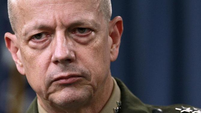 "FILE- In this March 26, 2012, file photo, Marine Gen. John Allen, the top U.S. commander in Afghanistan listens during a news conference at the Pentagon in Washington. The sex scandal that led to CIA Director David Petraeus' downfall widened Tuesday with word the top U.S. commander in Afghanistan is under investigation for thousands of alleged ""inappropriate communications"" with another woman involved in the case.  (AP Photo/Haraz N. Ghanbari, File)"