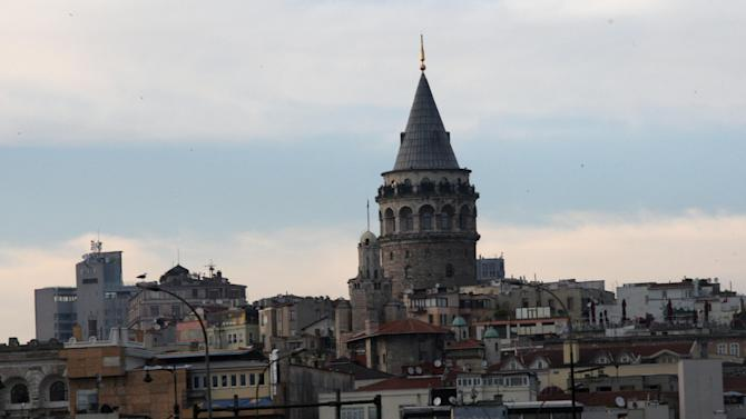 "FILE - In this May 10, 2011 file photo, one city's landmarks, Galata Tower is seen in Istanbul, Turkey.  On a moonlit night in the backstreets of Beyoglu, one of Istanbul's oldest districts, the worn facades and sharp-angled shadows recall the mournful character of the city that Nobel-prize winning Turkish author Orhan Pamuk described in a memoir. New, brash Istanbul charges ahead, and it's harder to uncover those pockets of dark ruin that epitomize ""huzun,"" the dense, communal melancholy that permeated the former imperial capital in Pamuk's work. As Turkey strives for global status, its leading city strains to channel expansion that threatens its heritage, environment and even its identity. (AP Photo/Burhan Ozbilici, File)"