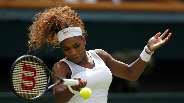 Serena Williams of the United States plays a return during her Women's first round singles match against Mandy Minella of Luxembourg at the All England Lawn Tennis Championships in Wimbledon, London, Tuesday, June 25, 2013. (AP Photo/Sang Tan)