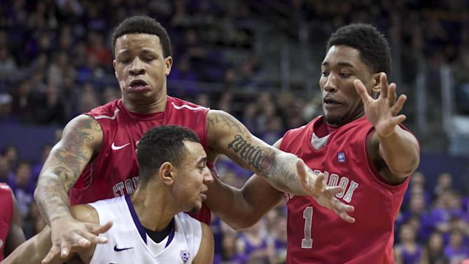 Stony Brook's Rayshaun McGrew, upper left, and Deshaun Thrower defend Washington's Nigel Williams-Goss, forcing him to call a timeout, during the second half of an NCAA college basketball game Sunday, Dec. 28, 2014, in Seattle. Stony Brook won 62-57. (AP Photo/Stephen Brashear)