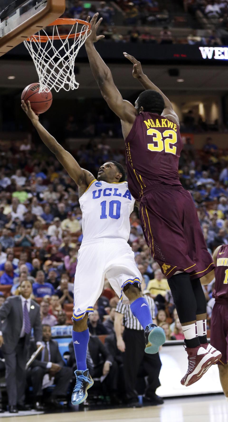 UCLA's Larry Drew II (10) shoots as Minnesota's Trevor Mbakwe (32) defends during the first half of a second-round game of the NCAA men's college basketball tournament Friday, March 22, 2013, in Austin, Texas.  (AP Photo/Eric Gay)