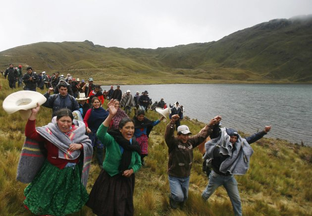 Andean people protest against Newmont Mining's Conga project during a march along the Perol lake in Cajamarca