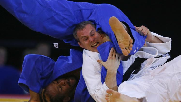 Scotland's Burton grapples with Dugasse of Seychelles in their men's -100kg weight category quarter-final judo match at the 2014 Commonwealth Games in Glasgow