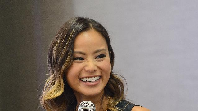 Actress Jamie Chung speaks to the attendees at the Simply Stylist Fashion & Beauty Conference at the Park Central Hotel on Saturday, Oct. 25, 2014, in New York. (Photo by Donald Traill/Invision/AP)