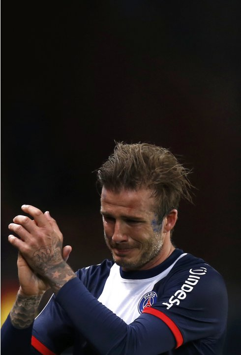 Paris Saint-Germain's David Beckham breaks down in tears as he leaves the pitch after being substituted in the 81st minute during his team's French Ligue 1 soccer match against Brest in Paris