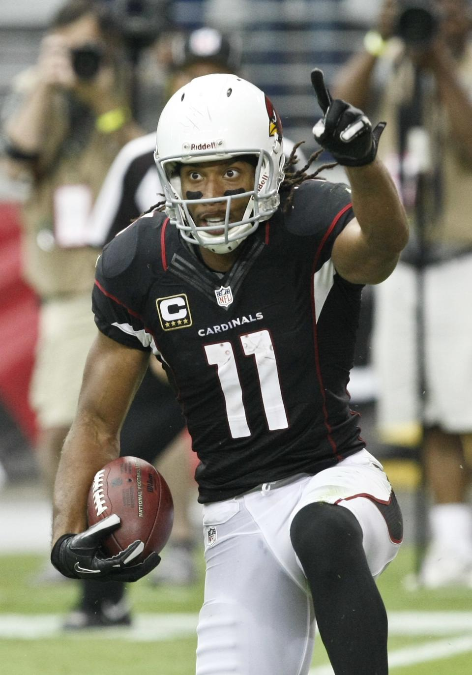 Arizona Cardinals' Larry Fitzgerald (11) celebrates his touchdown catch against the Philadelphia Eagles in the first half of an NFL football game on Sunday, Sept. 23, 2012, in Glendale, Ariz. (AP Photo/Rick Scuteri)