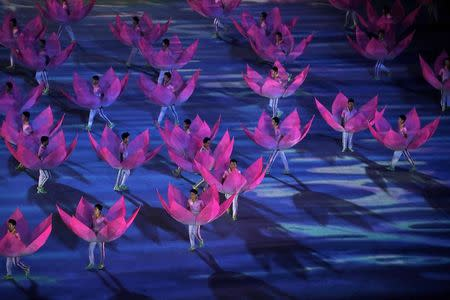 Performers dance during the closing ceremony of the 2014 Nanjing Youth Olympic Games in Nanjing