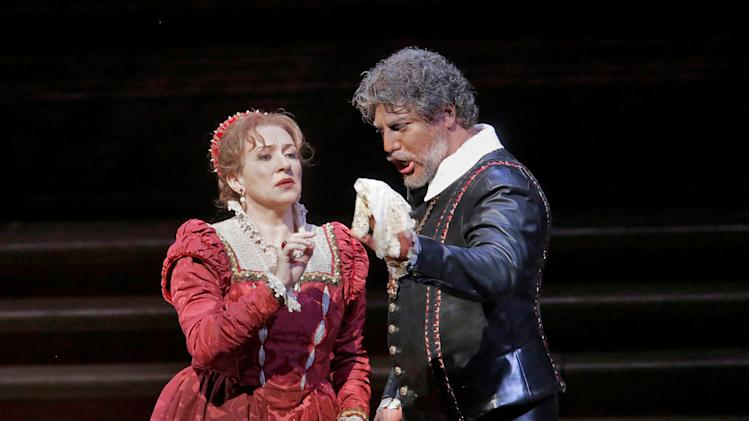 "In this March 11, 2013 photo provided by the Metropolitan Opera, Krassimira Stoyanova is in the role of Desdemona opposite Jose Cura in the title role during a performance of of Verdi's ""Otello,"" at the Metropolitan Opera in New York. (AP Photo/Ken Howard)"