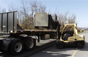 Materiel handler Darren Snyder loads Patriot missiles…