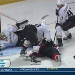 Jonas Hiller reaches back with his glove