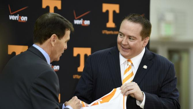 In this April 22, 2014, file photo, Donnie Tyndall, right, is introduced as Tennessee men's basketball coach by athletic director Dave Hart during a news conference in Knoxville, Tenn. Hart says he sees plenty of similarities between Tyndall and Volunteers football coach Butch Jones