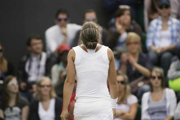 Sara Errani of Italy reacts during a third round women's singles against Yaroslava Shvedova of Kazakhstan during a third round women's singles match at the All England Lawn Tennis Championships at Wim
