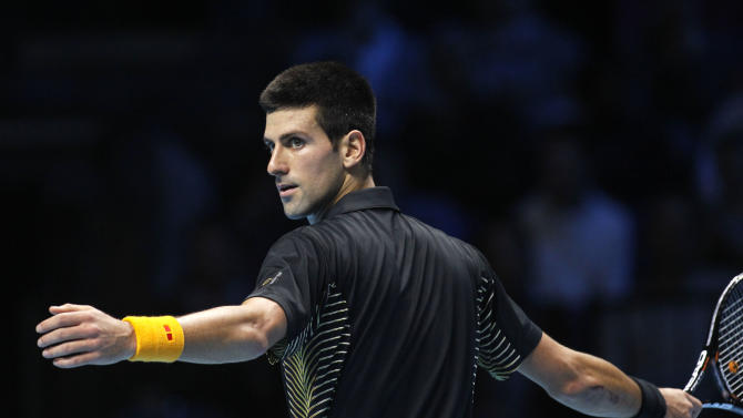 Novak Djokovic of Serbia reacts to a point lost to Andy Murray of Britain during their ATP World Tour Finals singles tennis match at the O2 Arena in London, Wednesday, Nov. 7, 2012. (AP Photo/Sang Tan)