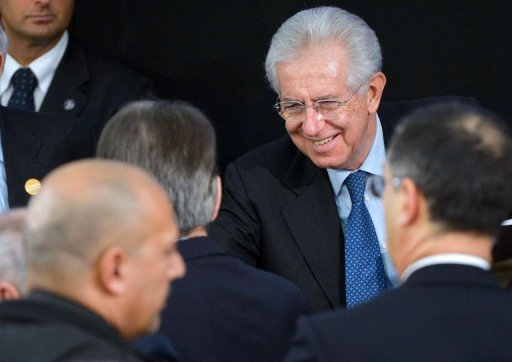 Italy's caretaker Prime Minister Mario Monti, pictured on December 23, 2012, told an impromptu news conference Friday that he will contest February elections at the head of a centrist coalition expected to counter a comeback by conservative former prime minister Silvio Berlusconi.