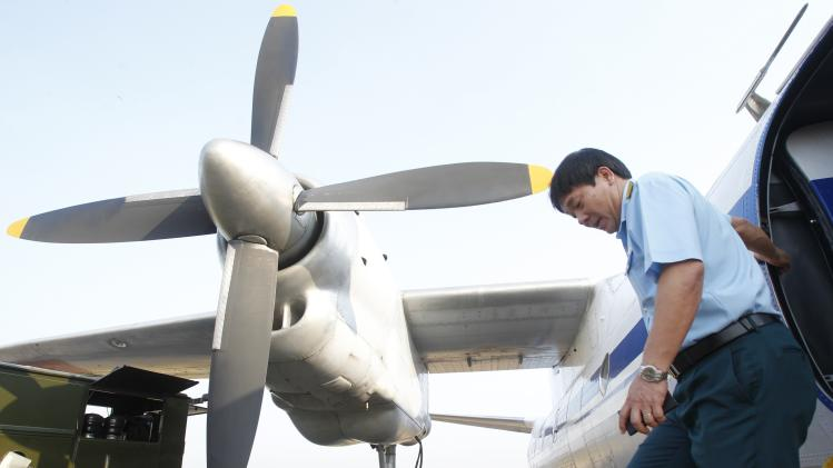 Senior Colonel Do Duc Minh leaves an AN-26 after performing flight safety checks at a military airport in Ho Chi Minh city
