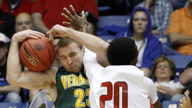 Vermont forward Brian Voelkel (23) fights for a rebound with Lamar guard Brandon Davis (20) during the first half of an NCAA tournament first-round college basketball game, Wednesday, March 14, 2012, in Dayton, Ohio. (AP Photo/Skip Peterson)
