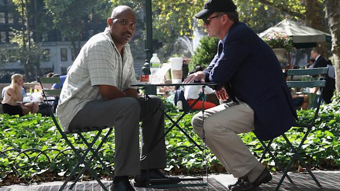 """This undated image from video released by NBC shows NBC News' Chris Hansen, right, meeting with an alleged hit man in New York's Bryant Park during the filming of a """"Dateline NBC"""" special """"Wild, Wild Web,"""" airing Friday, Oct. 26, 2012. Hansen negotiates with an alleged hit man and explores some of the strange and dangerous business being carried out online on sites like Craig's List. (AP Photo/NBC News)"""