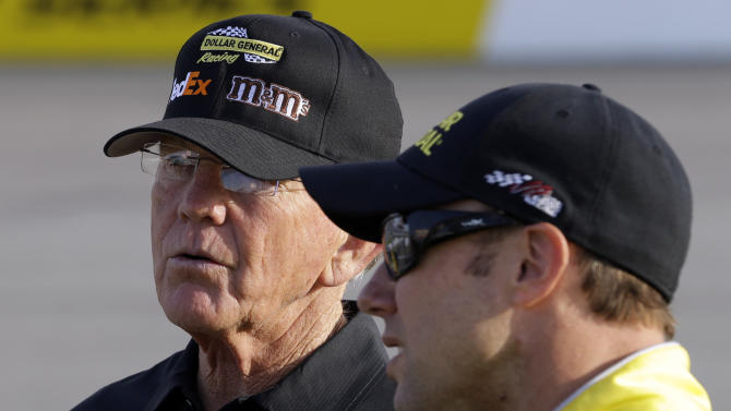 FILE - In this April 26, 2013, file photo, team owner Joe Gibbs, left, talks with driver Matt Kenseth during qualifying for the NASCAR Sprint Cup series auto race at Richmond International Raceway in Richmond, Va. A NASCAR appeals panel sided with Joe Gibbs Racing on Wednesday, May 8, 2013, and eased some of the penalties imposed for having an illegal part in Matt Kenseth's race-winning engine at Kansas last month.  (AP Photo/Steve Helber, File)