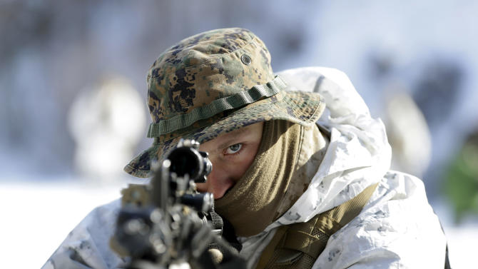 FILE - In this Feb. 7, 2013 file photo, an unidentified U.S. Marine from 3-Marine Expeditionary Force 1st Battalion from Kaneho Bay, Hawaii, aims his gun during a joint military winter exercise with their South Korean counterparts in Pyeongchang, east of Seoul, South Korea. As tensions rise on the Korean Peninsula, one thing remains certain: All sides have good reason to avoid an all-out war. The last one, six decades ago, killed an estimated 4 million people.  (AP Photo/Lee Jin-man, File)