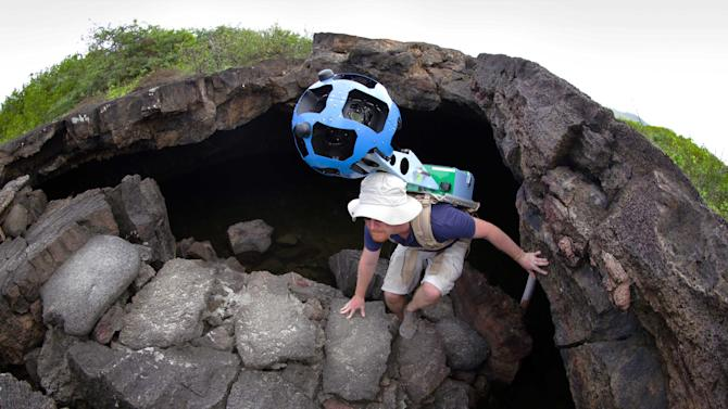 In this May 2013 photo provided by Google, Daniel Orellana of the Charles Darwin Foundation climbs out of an Isabela island where he was collecting imagery on the Galapagos. The lava landscapes found on the island help tell the story of the formation of the Galapagos. Few have laid eyes on many of the volcanic islands of the Galapagos archipelago that remain closed to tourists. But soon the curious will be able to explore these places that inspired Charles Darwin's theory of evolution from their computers or mobile devices. Google Maps sent crews armed with backpack-mounted Street View cameras and underwater gear to the Galapagos, and will be bringing the islands' natural wonders to the Internet. (AP Photo/Google)