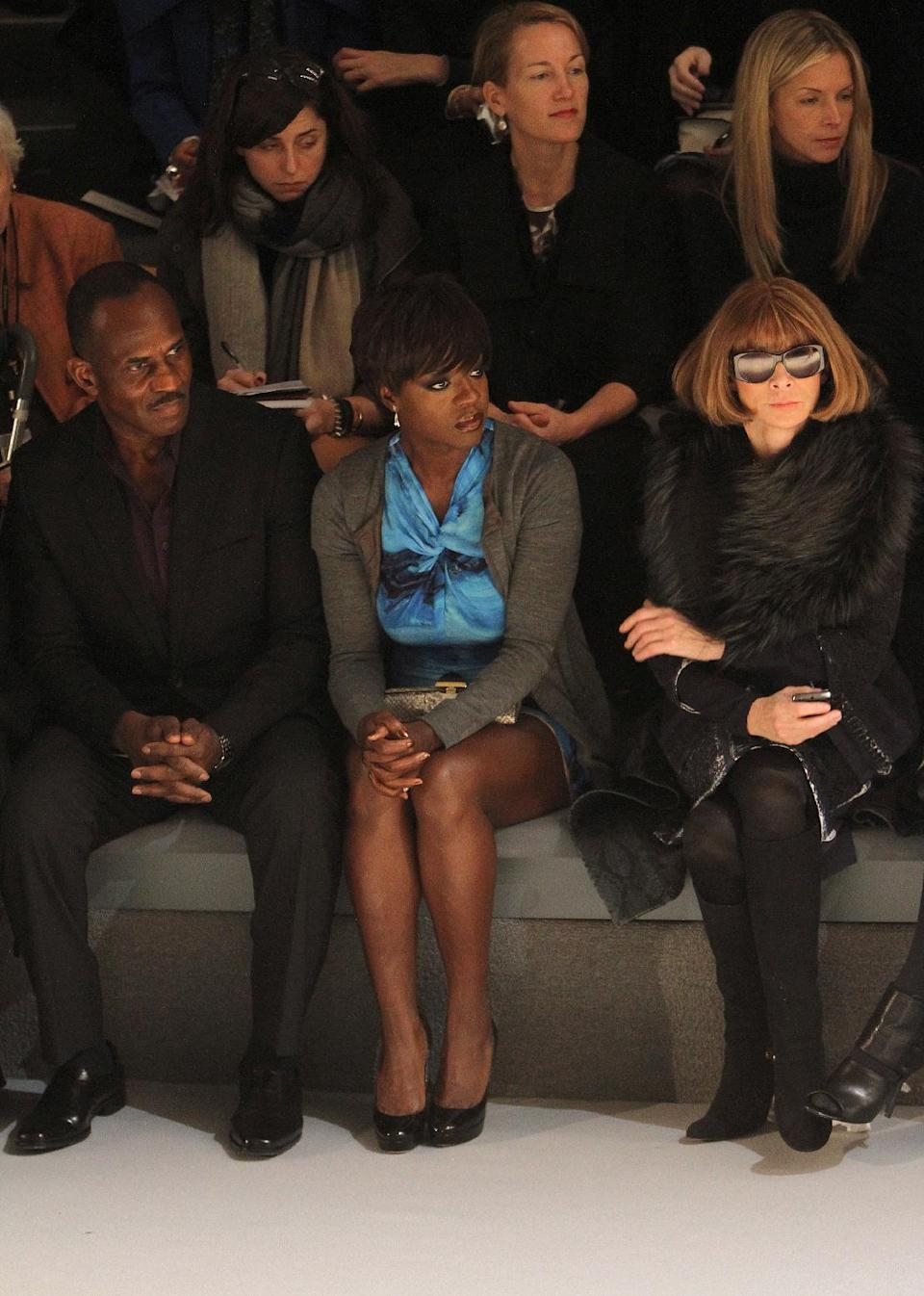 Actors Julius Tennon, seated front row from left, his wife Viola Davis, and American Vogue editor-in-chief Anna Wintour attend the Vera Wang Fall 2012 show during Fashion Week in New York, Tuesday, Feb. 14, 2012. (AP Photo/ Donald Traill)