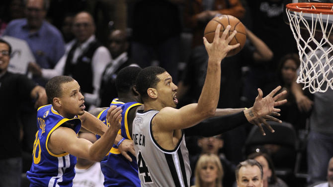 San Antonio Spurs' Danny Green, right, shoots against Golden State Warriors' Stephen Curry, left, and Draymond Green during the second half of Game 1 of the Western Conference semifinal NBA basketball playoff series, Monday, May 6, 2013, in San Antonio. San Antonio won 129-127 in double overtime. (AP Photo/Darren Abate)