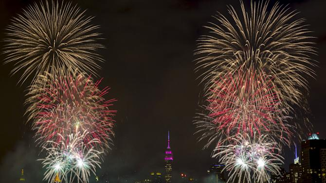 The Macy's 4th of July Fireworks explode for Independence Day over the East River in New York