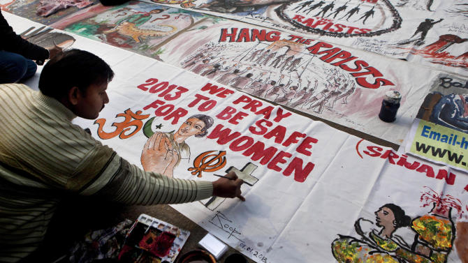 An Indian man makes a banner during a protest to mourn the death of a gang rape victim in New Delhi, India, Tuesday, Jan. 1, 2013. The gang-rape and killing of a New Delhi student has set off an impassioned debate about what India needs to do to prevent such a tragedy from happening again. The country remained in mourning Tuesday, three days after the 23-year-old physiotherapy student died from her internal wounds in a Singapore hospital. (AP Photo/Dar Yasin)
