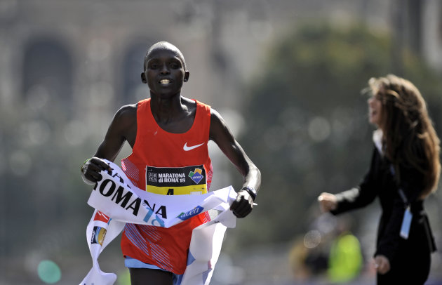 Kenya's Kanda Luka Lokobe crosses the finish line of the 18th Rome Marathon, 'Maratona di Roma',  on March 18, 2012 in Rome. AFP PHOTO / FILIPPO MONTEFORTE (Photo credit should read FILIPPO MONTEFORTE
