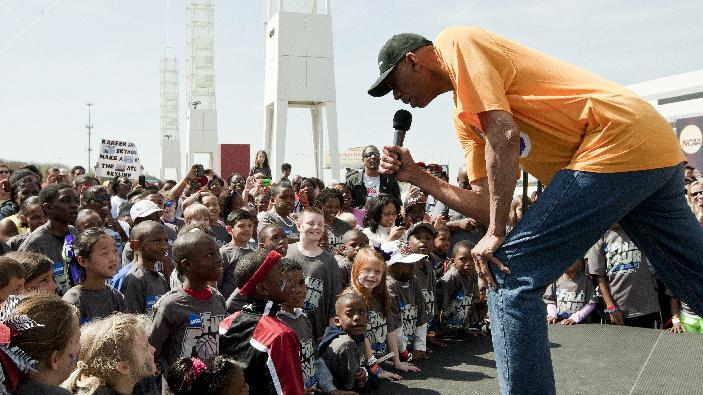 IMAGE DISTRIBUTED FOR POWERADE - NBA legend, Kareem Abdul-Jabbar, addresses a crowd of Atlanta families prior to the Final Four Dribble Fueled by POWERADE, on Sunday April 7, 2013, in Atlanta, Georgia. The Final Four Dribble Fueled by POWERADE featured 3,000 kids and family members dribbling basketballs on a one-mile trek down Andrew Young Boulevard in an effort to promote fun and healthy active lifestyles. (Photo by Wilford A. Harewood/Invision for POWERADE/AP Images)