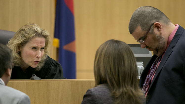 Judge Sherry Stephens talks with prosecutor Juan Martinez, left, and ...