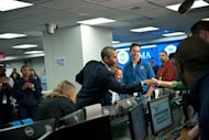 "US President Barack Obama shakes hands with Federal Emergency Management Agency workers after receiving a briefing on Hurricane Sandy at FEMA headquarters in Washington. President Barack Obama warned Americans to take Hurricane Sandy ""very seriously"" as authorities prepared a virtual shutdown of the Eastern Seaboard due to the impending mega-storm"