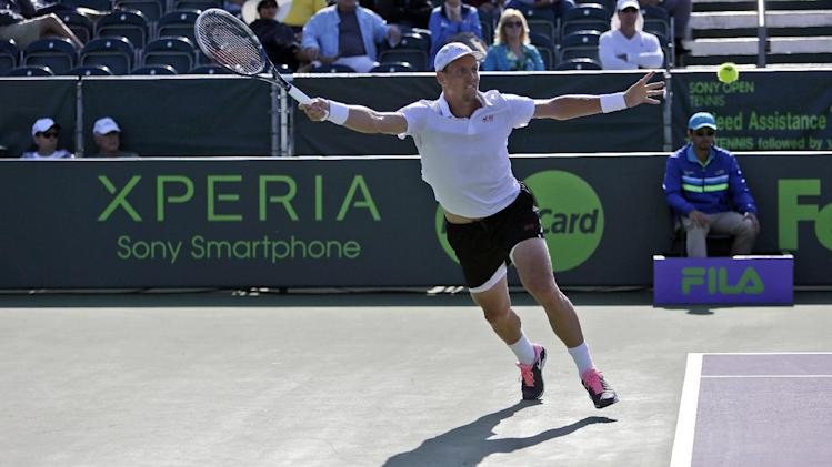 Tomas Berdych, of the Czech Republic, returns to Sam Querrey during the Sony Open tennis tournament, Tuesday, March 26, 2013, in Key Biscayne, Fla. Berdych won 6-1, 6-1. (AP Photo/Lynne Sladky)
