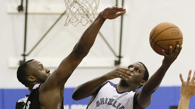 Memphis Grizzlies' Jordan Adams (1) makes a shot over Orlando Magic's Kadeem Batts (20) during an NBA summer league basketball game in Orlando, Fla., Tuesday, July 8, 2014