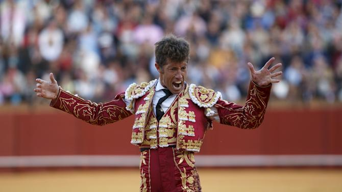 Spanish matador Manuel Escribano reacts after killing a bull during a bullfight in Seville, southern Spain