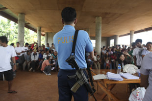 A policeman stands guard at the registration in Timanan, South Upi, Maguindanao. Photo by AMIEL MARK CAGAYAN.