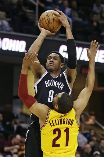 Nets beat Cavs to set franchise mark for road wins