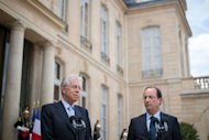 France's President Francois Hollande (R) and Italian Prime Minister Mario Monti speak to journalists after a working lunch at the Elysee presidential palace in Paris. The two sought to boost confidence that Europe can tackle its debt crisis