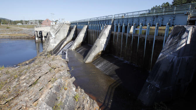 In this  Sept. 21, 2012 photo, the hydroelectric generating plant is seen in Wilder, Vt. Five big hydropower stations on Connecticut River are up for relicensing, which environmentalists say gives a rare opportunity to consider their combined impacts on one of New England's most important waterways. (AP Photo/Toby Talbot)