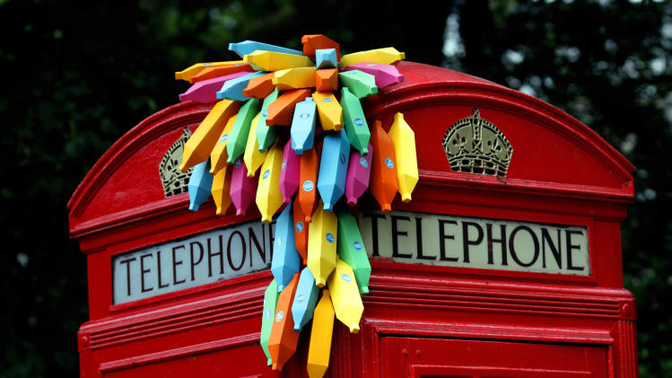An installation of paper bananas attached to a public telephone box, created by Brazilian graphic artist Breno Pineschi as part of as part of the arts campaign 'Rio Occupation London', is seen in South Kensington