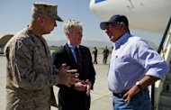 This file photo shows US Defense Secretary Leon Panetta (R) speaking with US Ambassador to Afghanistan Ryan Crocker (C) and the head of NATO coalition forces in Afghanistan General John Allen, in Kabul, in June. NATO-led forces are scaling back joint operations with Afghan forces after a spate of &quot;insider attacks&quot; in which Afghan recruits turned their weapons on Western allies