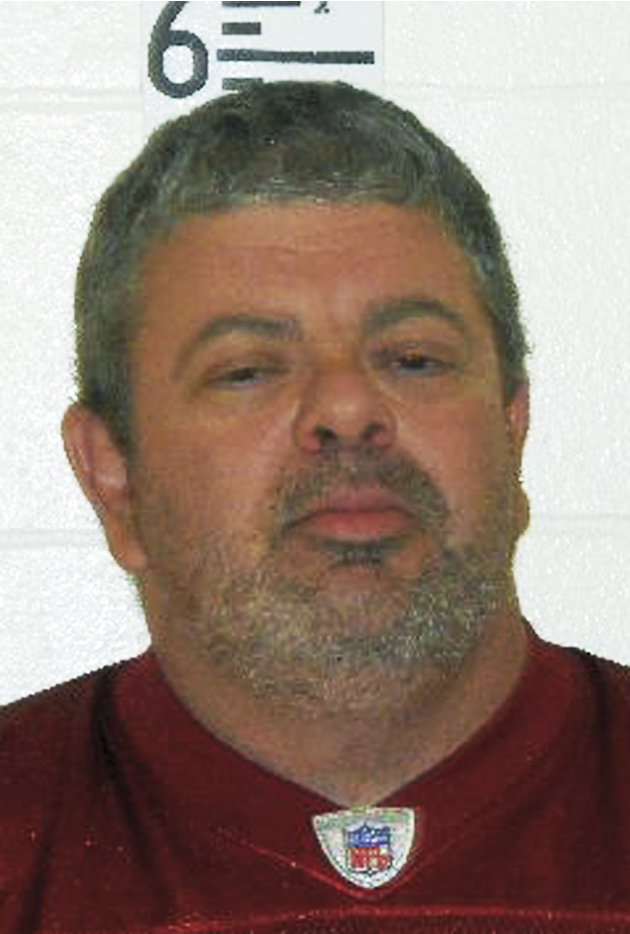 This booking photograph released by the Maine State Police shows Timothy Courtois, who was arrested Sunday, July 22, 2012 on charges of having a concealed weapon and speeding on the Maine Turnpike. Co