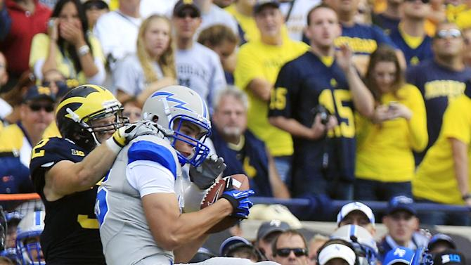 Michigan safety Jordan Kovacs, left, stops Air Force tight end Marcus Hendricks after a 15-yard reception during the first quarter of an NCAA college football game at Michigan Stadium in Ann Arbor, Mich., Saturday, Sept. 8, 2012. (AP Photo/Carlos Osorio)