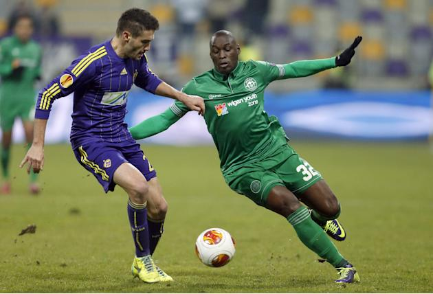 Wigan's Marc-Antoine Fortune, right, is challenged by Maribor's Aleksander Rajcevic during their group D Europa League soccer match, in Maribor, Slovenia, Thursday, Dec. 12, 2013